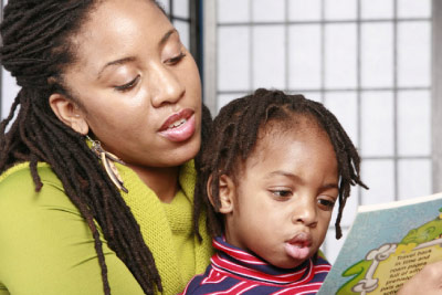 photo of woman reading to a child