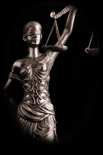 photo of a statue of justice holding scales