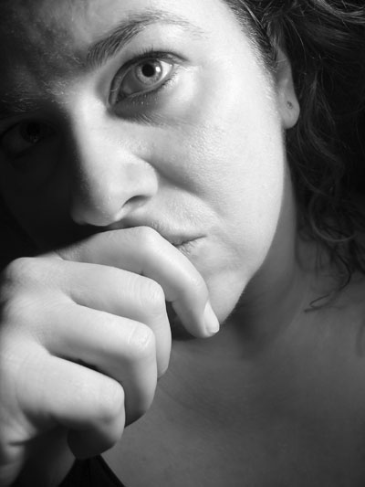 photo of a woman looking sad